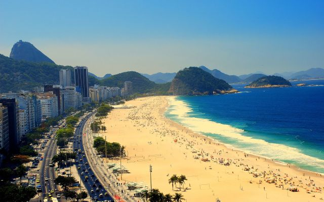 Copacabana beach in Rio de Janeiro, which does feature in the novel at several points