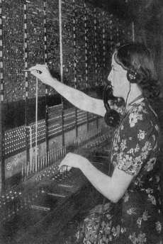 A picture of June Wright at work in the telephone exchange